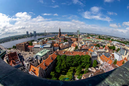 Fisheye aerial view of Riga city from st. Peters church in Latvia. Panoramic view of Riga with cloudy blue sky. Fisheye lens.