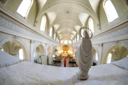 Statue of Virgin Mary from behind. Riga St. Albert Roman Catholic congregation, Roman Catholic Church in Riga, Latvia. Interior of the Roman Catholic Church. 報道画像