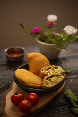 Empanada as breakfast by the window with flowers and sauces Zdjęcie Seryjne