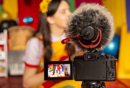 woman recording video for channel with children's program Imagens