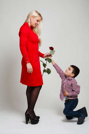 Son gives his mother flowers. Spring, March 8, International Womens, Mothers day, family holiday.