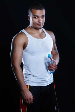 bathtowel: African athlete in the studio with water