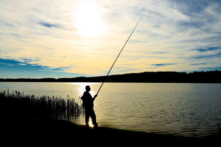 Fisherman silhouette by the sun Reklamní fotografie