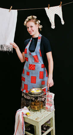 everyday: Typical everyday woman cooking in kitchen 6 Stock Photo