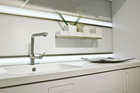 decorative objects: washing in the bright kitchen with decorative objects