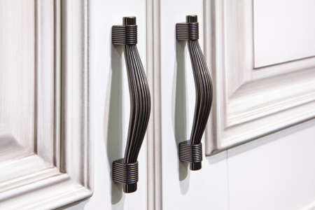 silver handles with snaps on  cabinet doors
