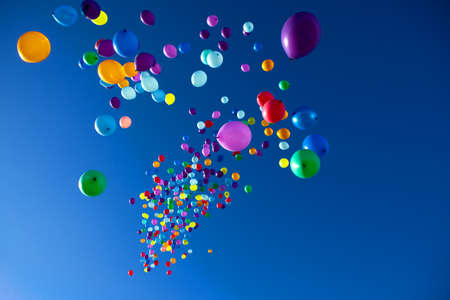 colorful balloons on a blue sky background Фото со стока