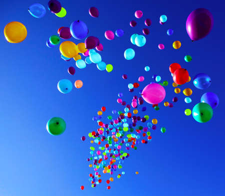 colorful balloons on a blue sky background Stock Photo