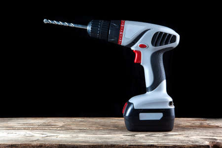 cordless: Cordless driver drill  on a dark background