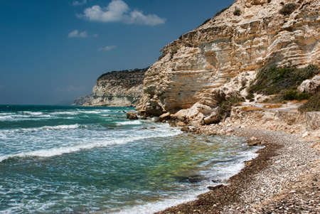 naturist: Rocky coast in Chalkidiki, Sithonia, Greece, with crystal clear water, hiding a small sandy beach Stock Photo