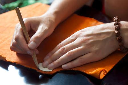 made to measure: Close up hands of a fashion designer at work with cloth