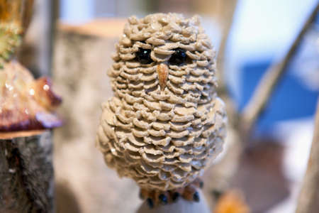 stone owl sculpture on stand .selective focus