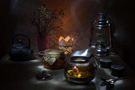 infusing: Tea ceremony. flower blooming in Glass teapot Stock Photo