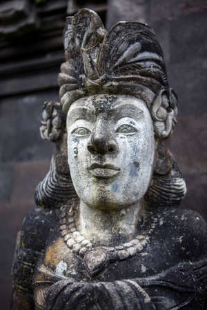 head stones: Stone sculpture on entrance door of the Temple in Bali