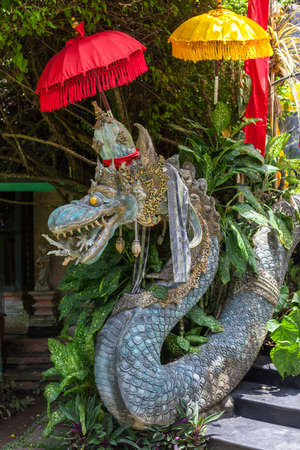 Stone sculpture of a snake guarding an entrance to the temple Stock Photo