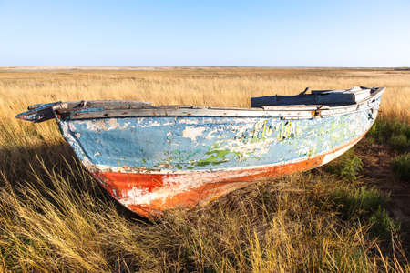 old wooden boat in the field. Beautiful scenic view