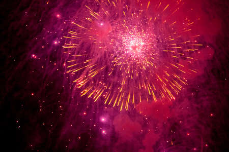 christmas backgrounds: fireworks explosions in the night sky. Close-up. Stock Photo