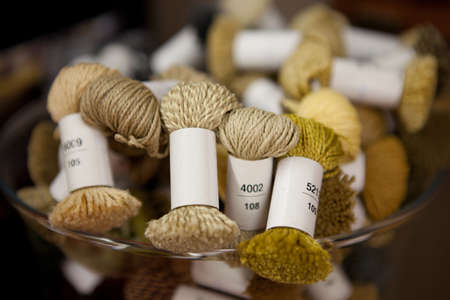 The texture of the wool yarn. Skeins of wool yarn in threads for knitting clothes.