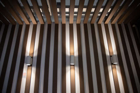 Modern lamps on the wooden wall of the interior.loft style room