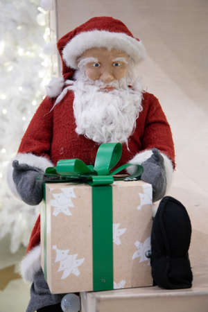 Santa Claus toy with beard and red hat Фото со стока