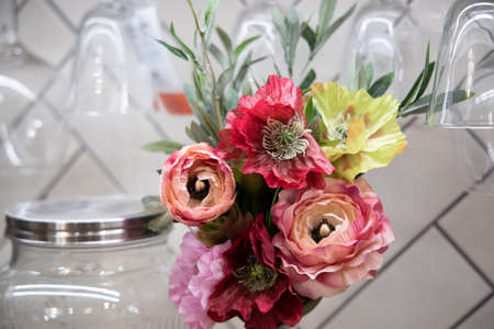 Bouquet from roses and other flowers on a table. Фото со стока