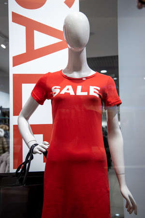 some mannequins wear a red shirt with the word