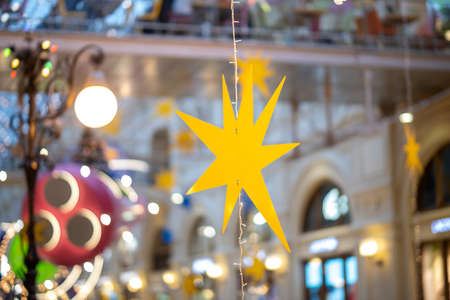 Yellow star Christmas decoration on the street and in the shopping center Фото со стока