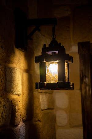 wooden lantern in the lock on the wall Фото со стока