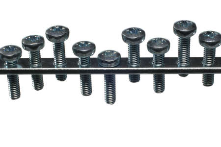 A series of screws put together in a threaded rod. photo