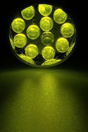 leds: 12 yellow LEDs shine on a surface. Stock Photo