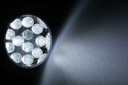leds: 12 white LEDs shine on a surface. Stock Photo