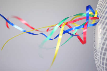 grate: Colorful ribbons fluttering in the air stream of a fan. Archivio Fotografico