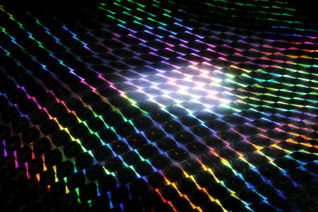 A prism separates white light into its colors. photo