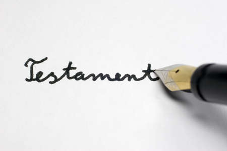 A Testament governs the inheritance of a person. Stock Photo