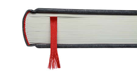 A bookmark in a book helps to find the correct page. photo