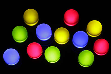 Twelve colorful LED lights in red, yellow, green and blue. Stock Photo - 7952793