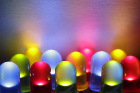 Twelve colorful LED lights in red, yellow, green and blue. Stock Photo - 7952794