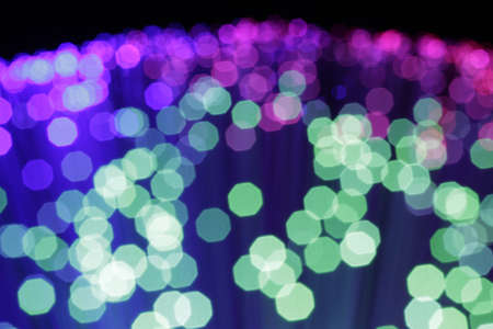 In optical fibers occurs colored light at the end. Stock Photo