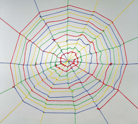 Colorful ribbons create a spider web many links and cross each other. Stock Photo - 9094445