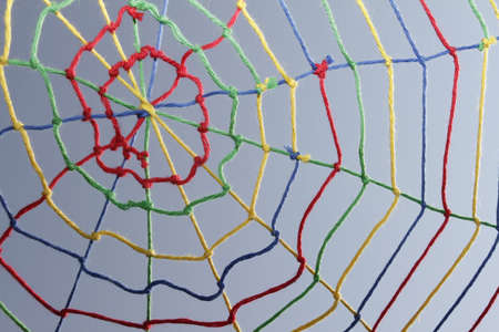 networked: Colorful ribbons create a spider web many links and cross each other. Stock Photo