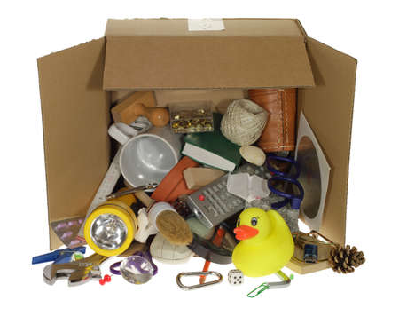 In a box are messy many things from the budget. Stock Photo