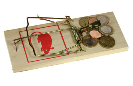 perilous: Money is attractive on a perilous rat trap. Stock Photo