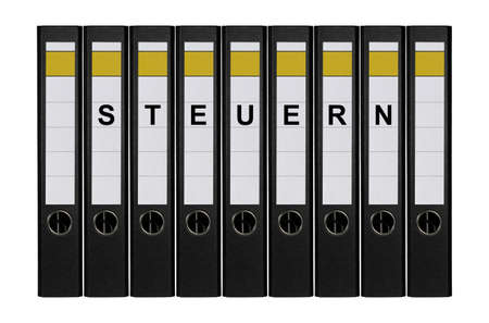 Nine ring binders labeled STEUERN standing side by side. photo
