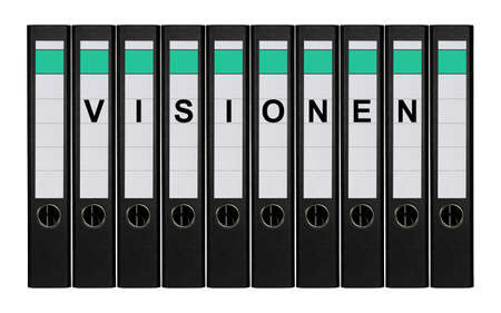Ten ring binders labeled VISIONEN standing side by side.