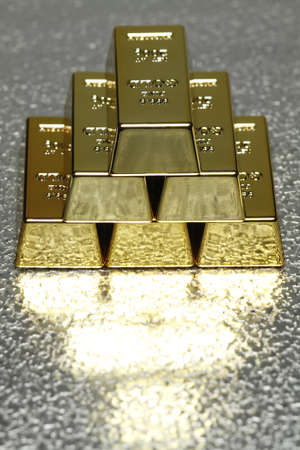 ingots: In the picture with several gold bullion is room for the added text available. Stock Photo