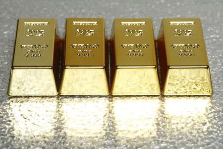 silver ingots: In the picture with several gold bullion is room for the added text available. Stock Photo
