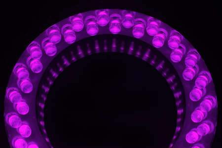 LEDs arranged circular in front of a dark background. photo