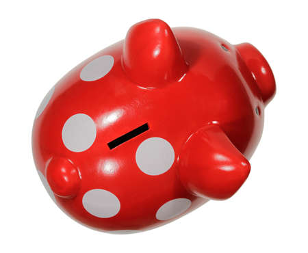 The photo shows a piggy bank from the top on a white background. photo