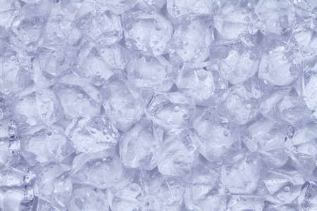 Much ice cubes with water drops lie next to each other.