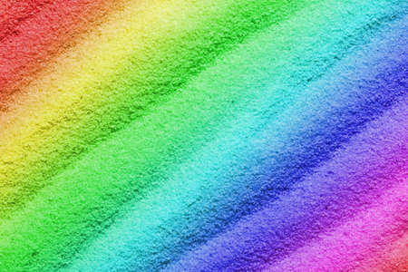 Colorful sand as the background image with wave-shaped structure